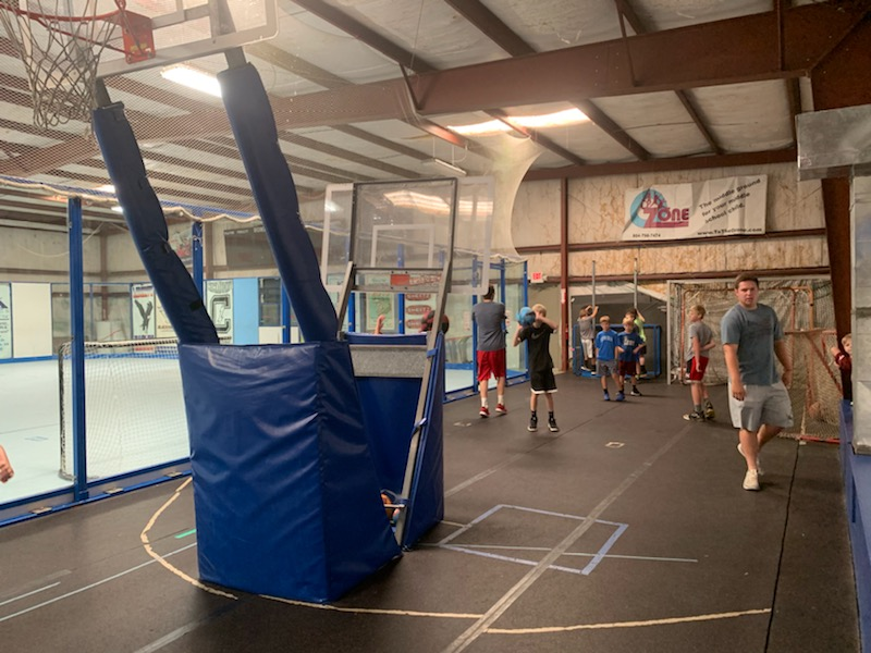 Think you can be the next champion in a game of Knock Out? With two baskets at different heights, The Hoop Zone is perfect for all ages to play basketball and shooting games!